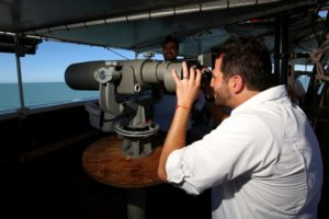 Secretary Pacchiano Alamán spots a vaquita through the 'big eyes' (Photo by Todd Pusser).
